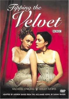 Rachel Stirling and Keeley Hawes are sitting together in their victorian under garments infront of a large red curtain.  The text Tipping the Velvet is in white italic writing above them.