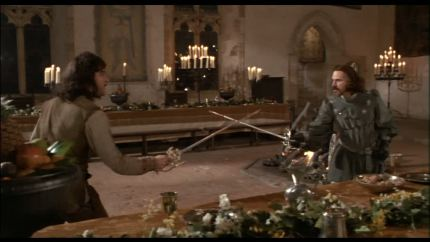 The setting is the Barons Hall at Penshurst Place which has been decorated for a candelight feast.Inigo Montoya (Mandy Patinkin) and Count Rugen (Christopher Guest) are duelling in their medieval costumes.