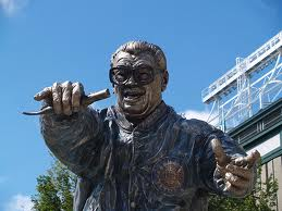 "On the North Side of Chicago, there is a statue of Harry Caray, and on the south side there is an owner who refers to Harry and ""scum."""