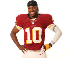 If you want to see RG3 smile like this, you need a time machine.  If RG3 had a time machine, turning it back to the moment he flipped on the national spotlight would be a good destination.