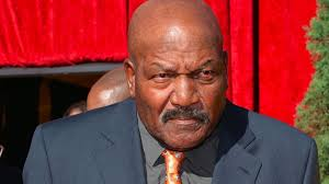 Jim Brown shows up with a grimace, even self-immersed doofuses like college presidents will listen intently to what he has to say.
