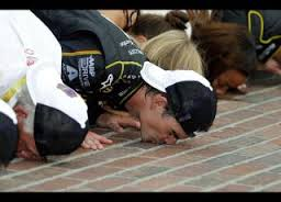 Jeff Gordon kisses the bricks in front of a two-thirds empty Indianapolis Motor Speedway.