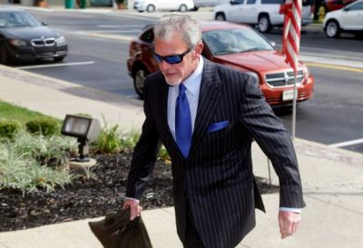 Colts owner Jim Irsay walks into the Hamilton County Cpurthouse yesterday - the building where justice should be meted out.