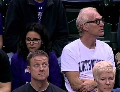 Julia Louis-Dreyfus (with husband Brad Hall) cheered like a normal basketball mom yesterday as her son's Northwestern team lost to Michigan in OT.