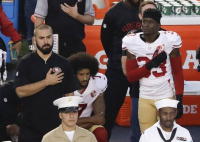 Colin Kaepernick kneels during the National Anthem prior to last night's game.