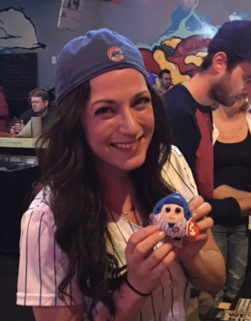 "Our server at Fat Dan's with my wife's good luck Cubs beanie key chain. Moments after this pic was taken, the Cubs won and she repeatedly asked, ""Is he OK?"" as I wept."