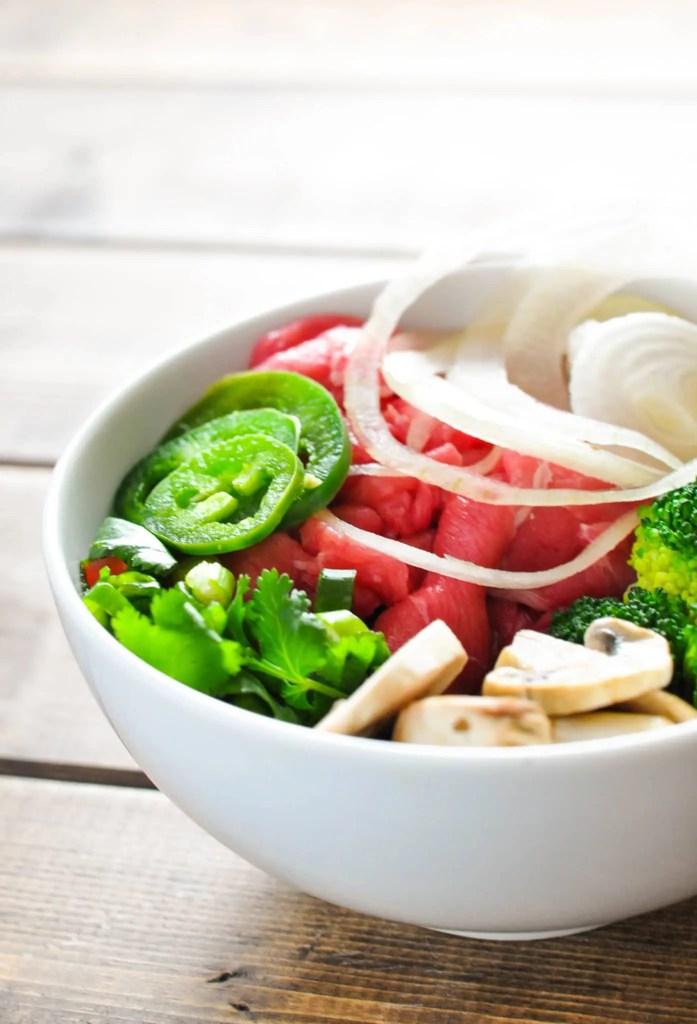 Low Carb Pho - Vietnamese Noodle Soup [Recipe] | KETOGASM.com #keto #ketogenic #lowcarb #lchf #atkins #pressurecooker #recipes #pho #noodlesoup #soup #vietnamese
