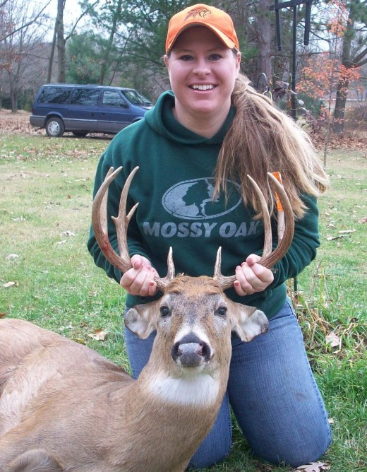"""Big Pine Marge lives in the woods off a dirt road where she fiercely defends her right to have electricity. """"Especially refrigeration because warm beer sucks."""" She is pictured here with an animal that is NOT a Key Deer."""
