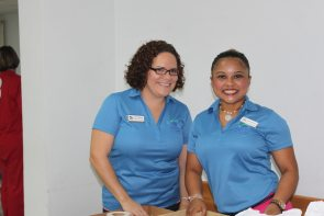 Habitat for Humanity board members Elba Ornelas, left, and Katia Chacon help with the spelling bee administration.