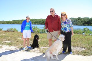 Seasonal residents Joey and Kathy Czarkowski and friend Bonnie Leonard, who is visiting from Ohio, visit the waterpark with their dogs Max and Willow.