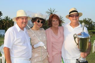 Croquet winners Chuck Gillmore and Larry Johnson are joined by their wives Norma and Dee in celebration of the coveted trophy.