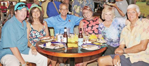 Marc and Tammy Hollander from the Coconut Castaways, Artist Koz, Cheryl Johnson, and Joanne and Scott Cates gather at a table. The 400-plus members of Southernmost Coconut Castaway members do a ton of volunteer — logging more than 1,000 hours last year.