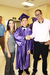 Max Mealor of Key West High School, with his mom Alisa, shakes hand with mentor Mike Mongo. Max is heading off to UCF.