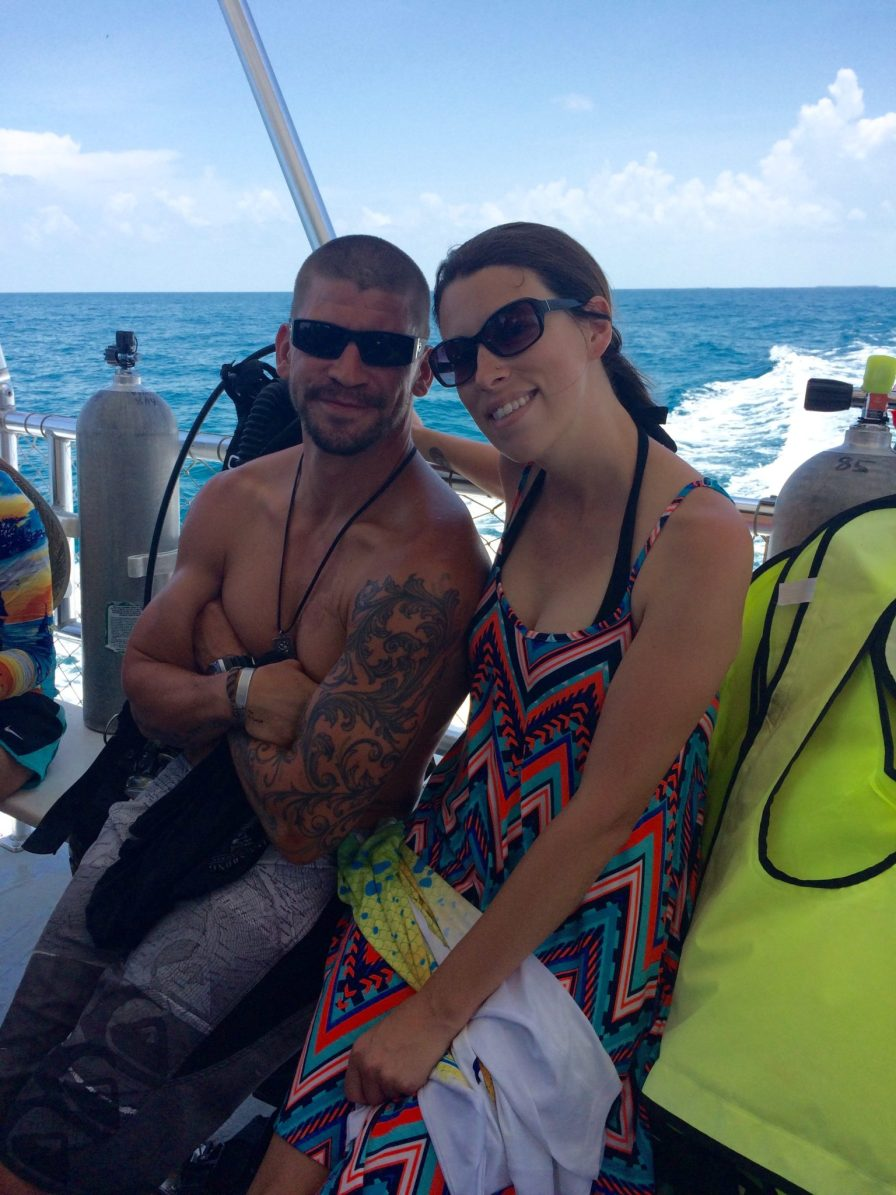 """Army Ranger Roland Vaughan from Alabama started diving after he was injured four years ago. """"I look forward to this trip every year,"""" he said. He is sitting with friend Jaclyn Miller, a teacher at Sigsbee Elementary, who is a volunteer safety diver on the trip."""