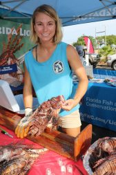FWC Researcher Meaghan Faletti measures and collects stomach content data on the lionfish, paying particular notice to the variations in Gulfside and Oceanside catches.