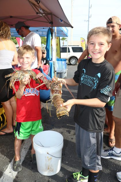 Marathon's Chase Leird and Tommy Norris weigh in their lobsters for the kid's division.