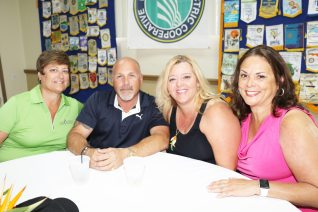 Joe Caliguiri shares a table with Lisa Kaminski, Leigha Fox and Maggie Gutierrez. Joe was on hand to represent Tarpon Creek which walked away with best pizza honors.