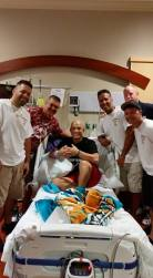 Local firefighter and cancer fighter Frankie Gutierrez, center, receives a visit from Key West Fire Department friends during a recent hospital stay in Miami.
