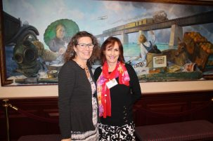 Fittingly, Florida Keys Council of the Arts' Susan D'Antonio and E.D. Elizabeth Young pose in front of a Florida Keys portrait along the side of the House Floor at the state capital.