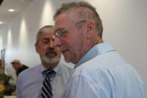Marathon attorney Frank Greenman, left, chats with developer Pritam Singh.