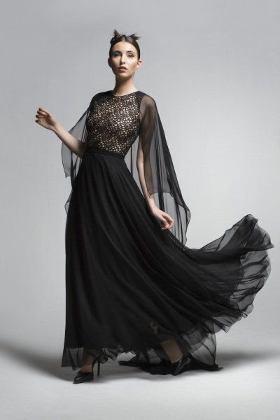 The flowy, femininity contrasted against the strong black of this creates a stunning piece.