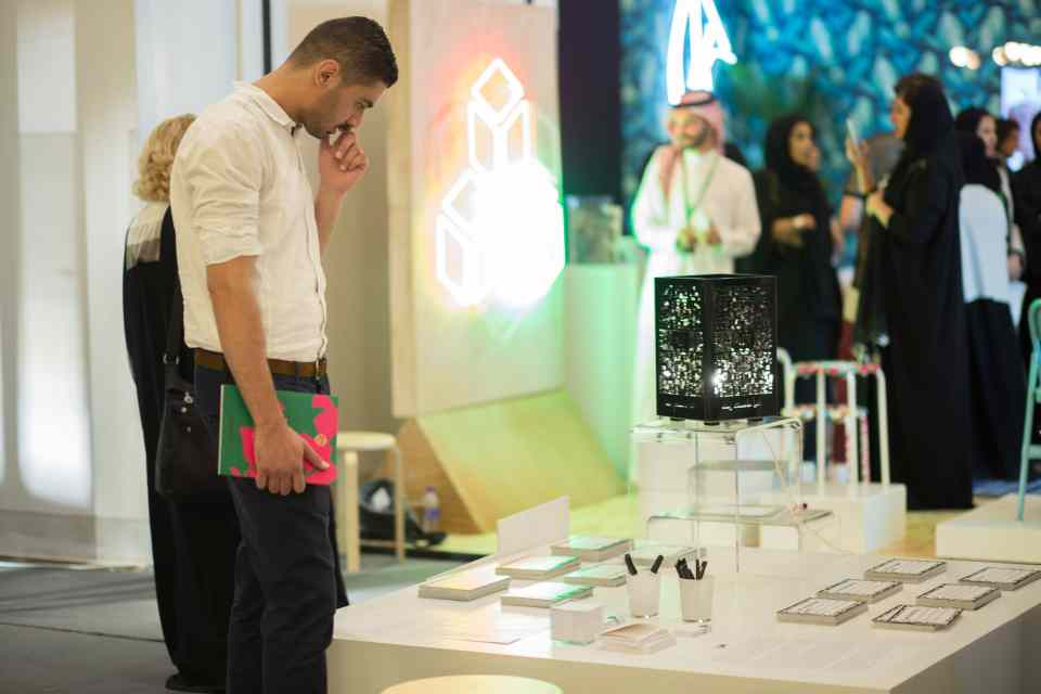 Audience interacting with Nayla Al Attar's piece at SDW