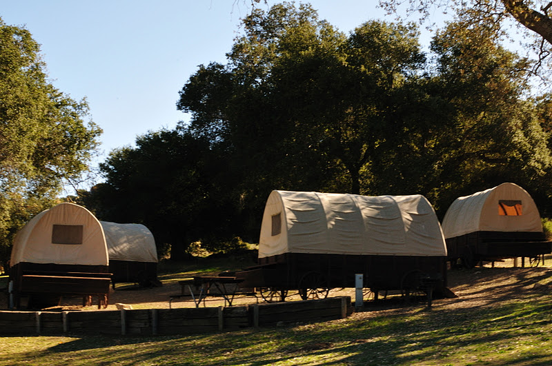 The covered wagons feature four cots for sleeping, and lots of fun.