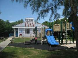 Playgrounds are conveniently located outside bathroom facilities.
