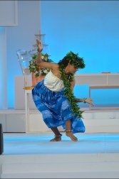 A dancer on the main stage of the ceremony, performing dance and mele (song).