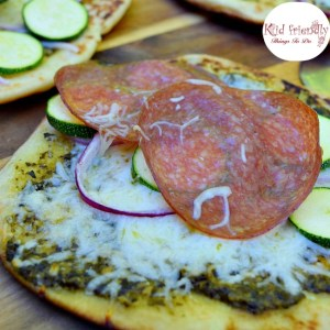Grilled Pesto Zucchini and Salami Naan Bread Pizza Recipe - Delicious and so easy to make. Perfect for appetizers or a meal! www.kidfriendlythingstodo.com