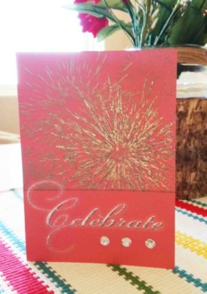 Celebrate handmade card textured gold burst design on red