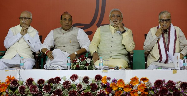 epa04157692 (L-R) Bhartya Janta Party's (BJP) senior leader L K Advani, party President Rajnath Singh, prime ministerial candidate Narendra Modi and Chairman of the Manifesto Committee Murli Manohar Joshi are pictured prior to release of the BJP's Election Manifesto in New Delhi, India, 07 April 2014. Steps to boost the economy and administrative reforms were among the measures India's main opposition party BJP promised in its election manifesto. The 20-page document marked development, especially of underdeveloped areas like the northeast and Jammu and Kashmir, the creation of jobs and better infrastructure as priorities.  EPA/HARISH TYAGI##########X##########EPA