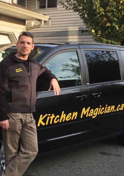 Justin standing by Kitchen Magician car