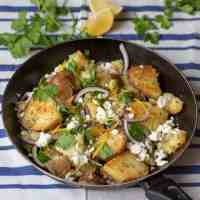 Greek Potato Hash - A quick and simple dish to serve as a main course or as a side. The crispy potatoes work so well with the creamy feta and tangy lemon!