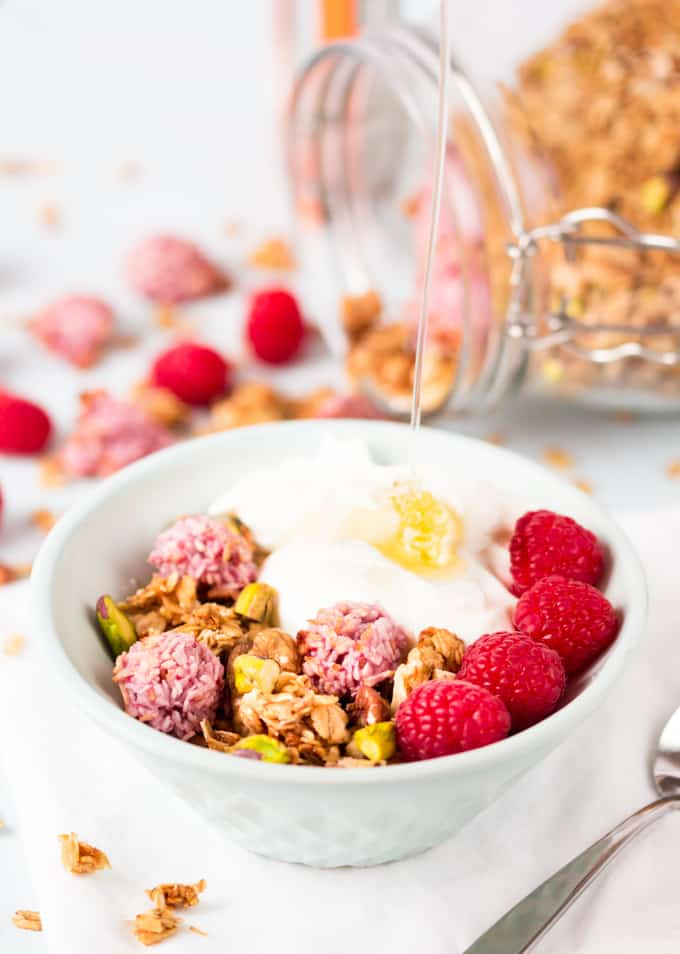 Crunchy, coconut oil granola topped with super-quick, fresh raspberry macaroons.