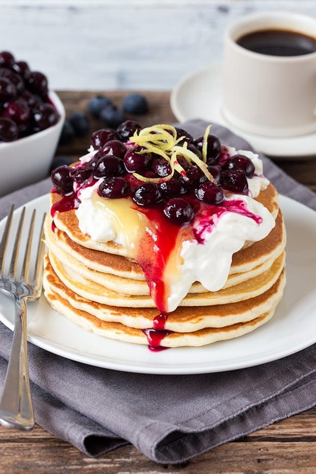 A perfectly legitimate way to have cheesecake for breakfast! These blueberry lemon cheesecake pancakes are quick, easy and amazing!