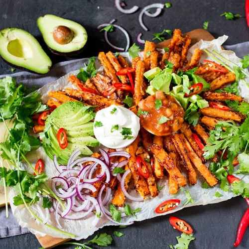 A lighter alternative to those crisps and dips - try my loaded Mexican-style carrot fries! A great party food, snack or lunch. Vegetarian and gluten free!