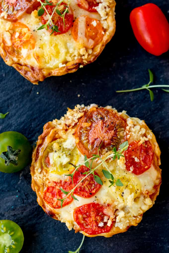 Cheese and Tomato Tarts with a rich tomato ragu and creamy béchamel sauce encased in shortcrust pastry. The best vegetarian lunch!