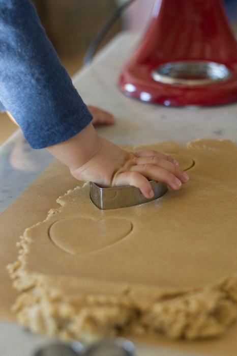 little hands cutting hearts