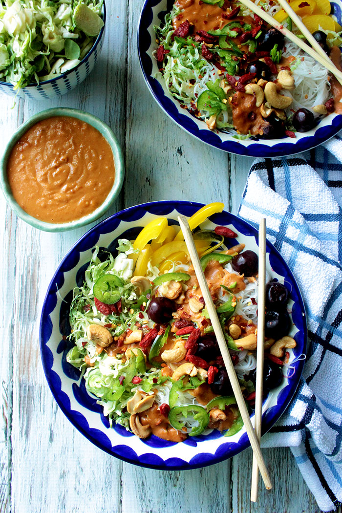 rice noodles may be served hot or cold, and are full of crisp veggies. Topped with a simple spicy peanut sauce, these is a super easy empty-out-the-fridge weeknight dinner