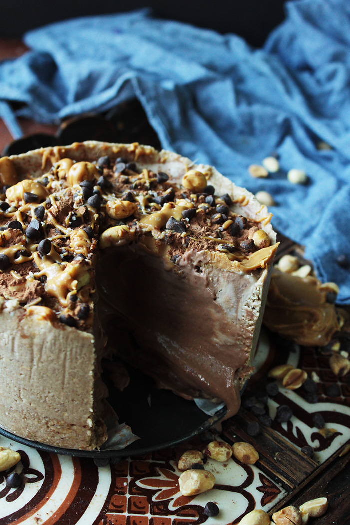 This frozen peanut butter pie is vegan, gluten-fee, and so easy. Creamy chocolate and peanut butter swirl is piled inside a no-bake optional crust for a rich and cooling treat.