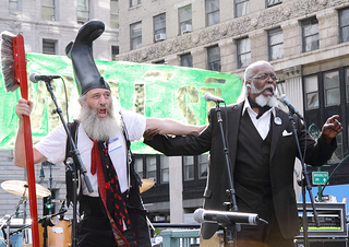 Vermin Supreme (with a boot on his head &amp; toothbrush) with a friend in a suit