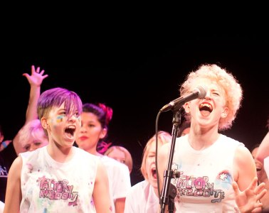 """Girls Rock Lawrence campers perform the """"Girls Rock Lawrence"""" theme song at the second annual GRL camp showcase on Saturday, June 11, 2016 at Liberty Hall."""