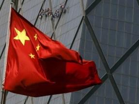 10月28日、国際通貨基金(IMF)の李昌鏞(イ・チャンヨン)アジア太平洋局長は28日、中国の人民元がIMFの特別引き出し権(SDR)に採用されれば、アジアの金融市場に大きな影響をもたらすとの認識を示した。北京の金融街で4月撮影(2015年 ロイターー/Kim Kyung-Hoon)