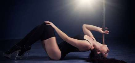 beautiful young woman performing pole dance