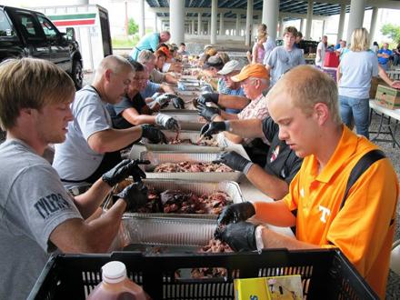 Volunteers help feed the homeless.