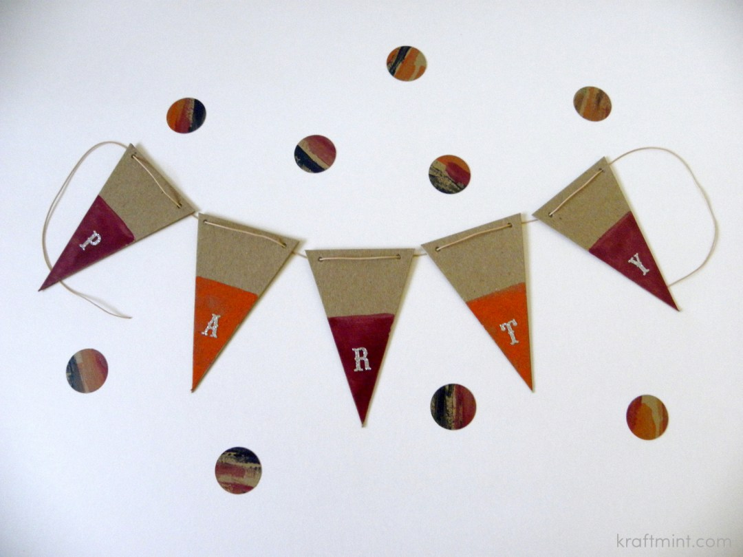 """This was so much fun to make. I colorblocked each pennant with Julep's nail polish and then spelled the word """"party"""". I used a natural leather cord to hold the pennant together."""