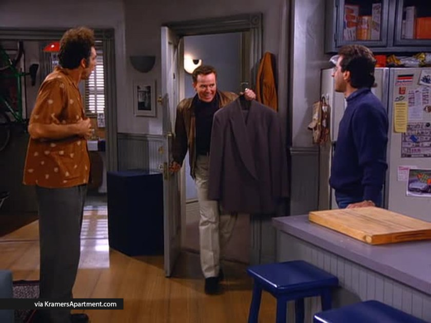 Picture of Kenny Bania in Jerry's apartment delivering the Armani suit jacket
