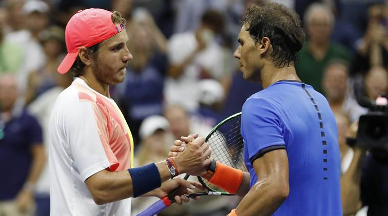 Lucas Pouille, of France, shakes hands with Rafael Nadal, of Spain, after winning their match during the fourth round of the U.S. Open tennis tournament, Sunday, Sept. 4, 2016, in New York. (AP Photo/Alex Brandon)
