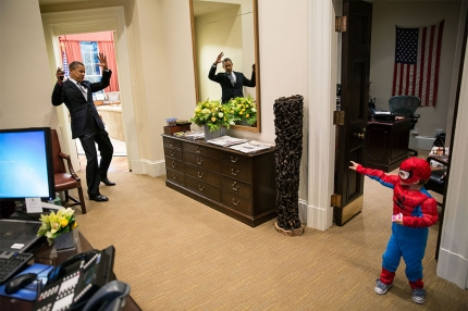 President Obama pretends to be caught in Spider-Man's web as he greets Nicholas Tamarin, 3, just outside the Oval Office. Nicholas was trick-or-treating with his father, White House aide Nate Tamarin in the Eisenhower Executive Office Building. (Official White House Photo by Pete Souza)